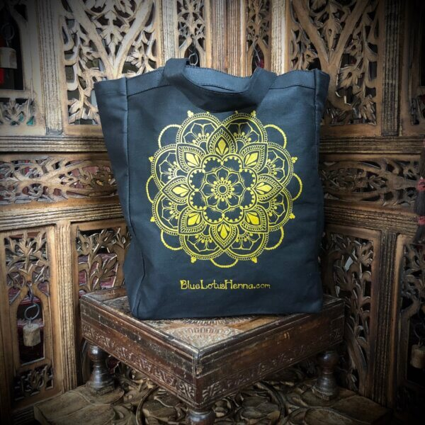 Black cotton canvas tote bag with metallic gold mandala screen print