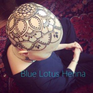Henna tattoo mandala crown design on female scalp