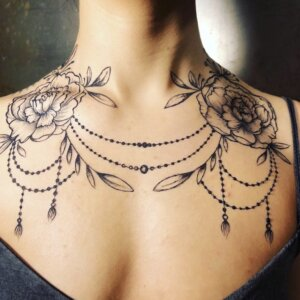 Jagua tattoo peony and chain design on female chest