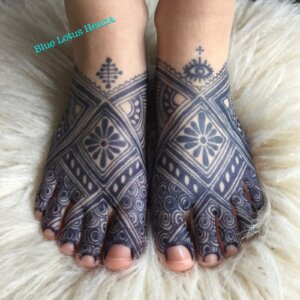 Jagua tattoo stain mandala design on female feet