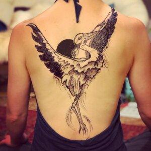 Jagua tattoo modern heron female back design