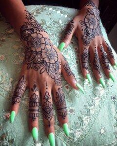Jagua gel tattoo floral design on female hands