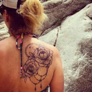 Jagua tattoo stain of peonies and moon on female shoulder blade/ back