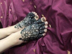 Floral jagua design on female feet in madhubani style