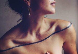 Jagua Tattoo stain stripe across female decolete