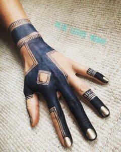 Jagua tattoo stain on female hand bold geometric