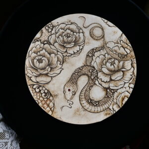 Henna painting of snake and peony flowers