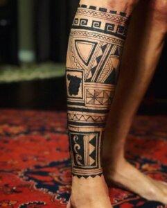 Jagua tattoo male calf sleeve Polynesian inspired