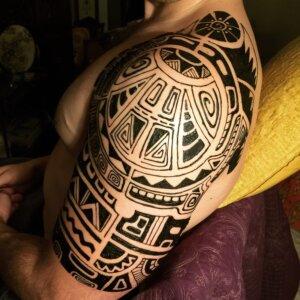 Jagua tattoo male shoulder half sleeve Polynesian inspired