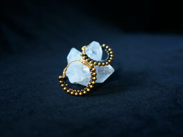 earrings wrapped in black thread