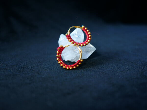earrings wrapped in red thread