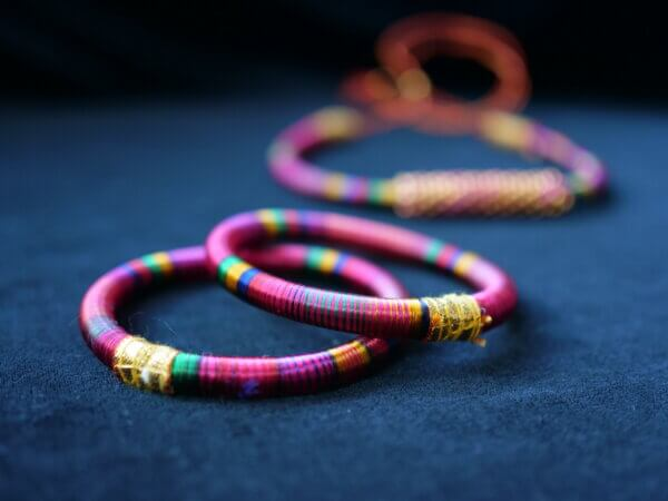 pink hand wrapped thread bangles and choker necklace