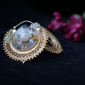 Intricate brass Rajasthani earrings with rainbow moonstone