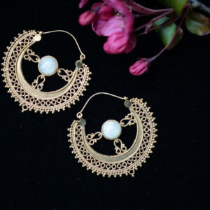 Intricate brass Rajasthani earrings with rainbow moonstone