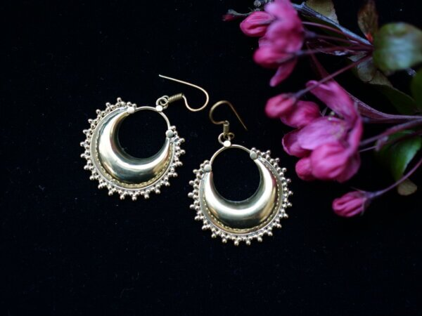 Brass moon earrings with decorative edges