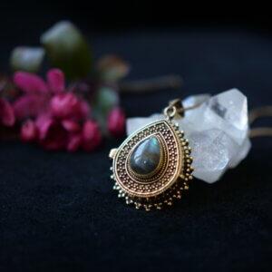 Drop shaped locket pendant with labradorite setting
