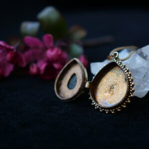 Drop shaped locket pendant with labradorite setting