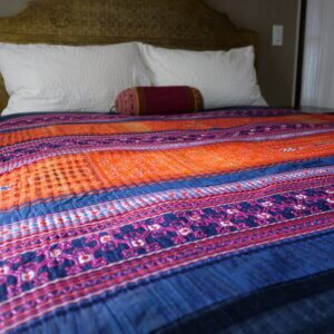 Multi colored Hmong textile bedspread