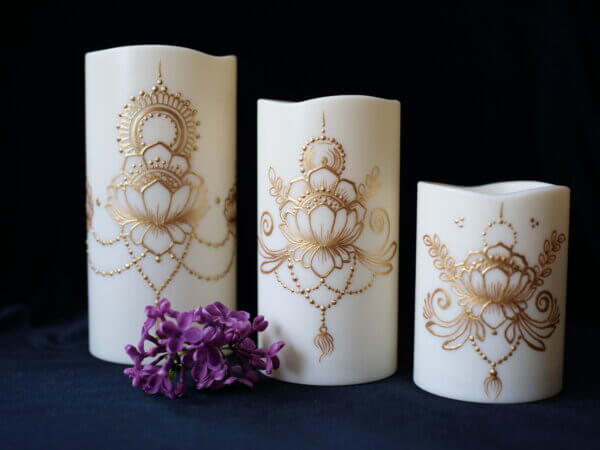 Set of 3 LED candles in various sizes, each hand painted with a lotus design