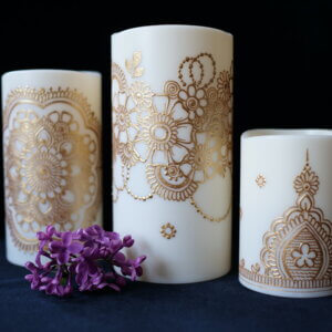 Set of 3 LED candles in various sizes, hand painted with designs in metallic gold