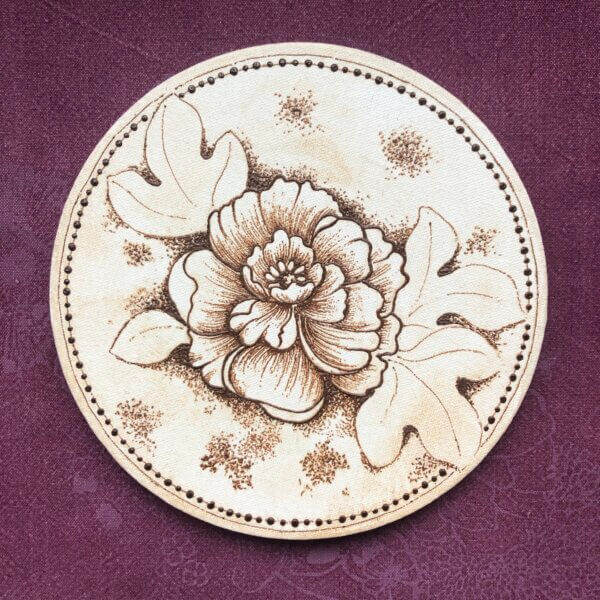 Circular canvas with henna painting of a peony flower