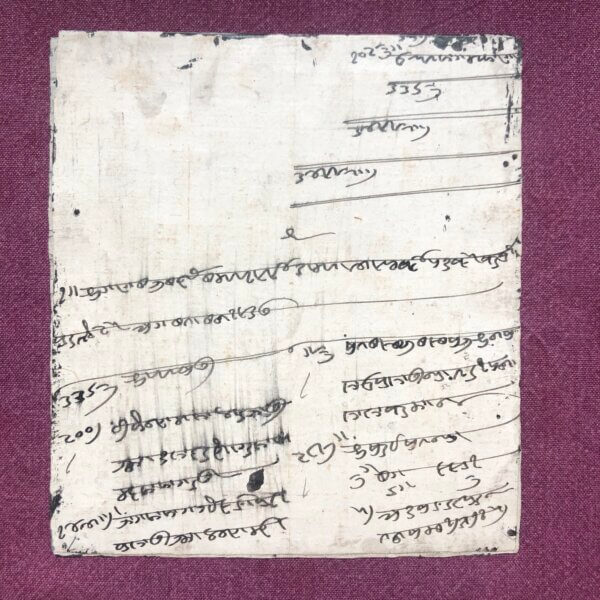 back side of painting with Hindi script on it