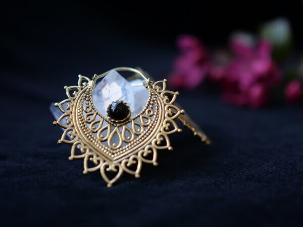 Onyx and brass earrings in a petal shape with mehndi style designs