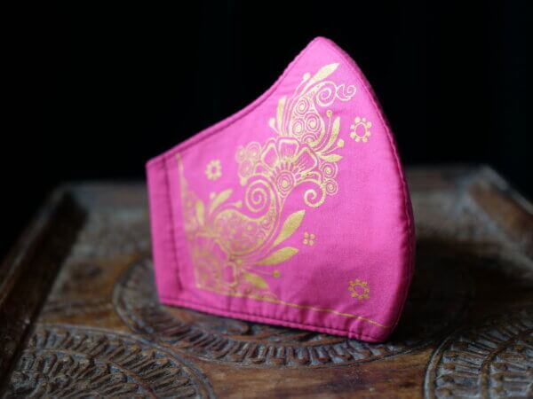 pink cotton face mask with hand painted mehndi design in gold