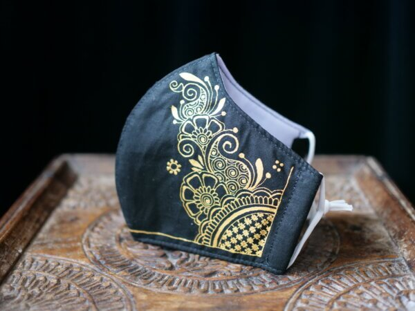 black cotton face mask with hand painted mehndi design