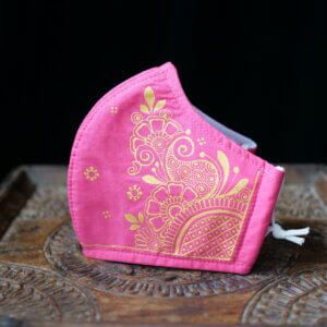 Pink cotton face mask with hand painted henna design in gold