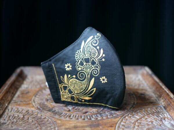 black cotton face mask with hand painted mehndi design in gold